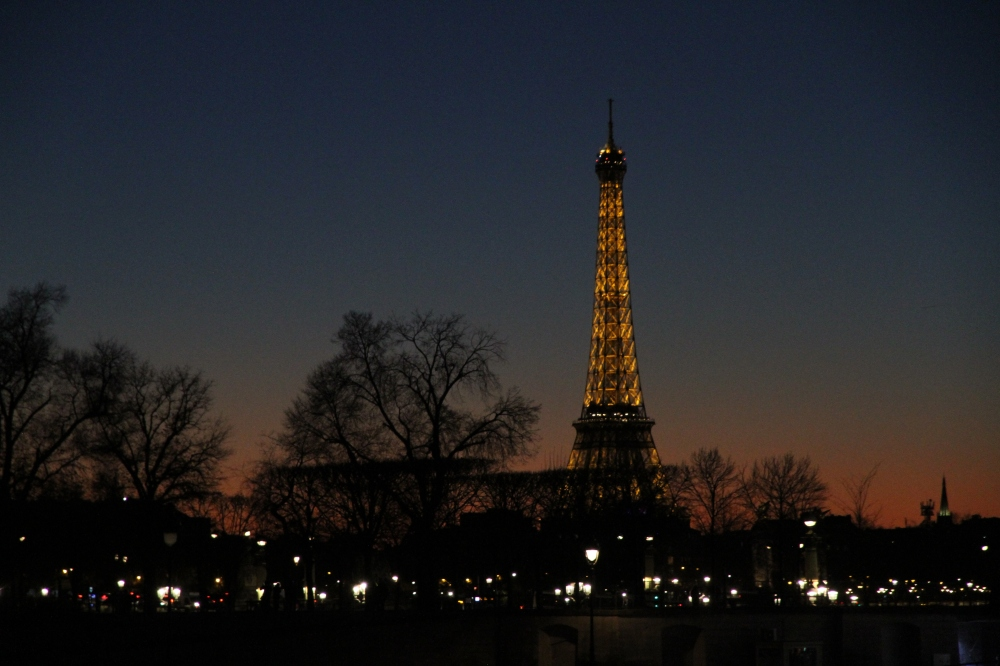 Eiffel Tower illuminated at dusk